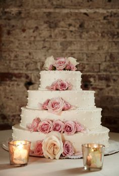 Brides.com: The Most Pin-Worthy Real Wedding Details of the Week: May 9, 2014. A four-tiered white wedding cake, from caterer Spoonbread, is adorned with fresh blush roses. Inside the dotted buttercream confection are layers of red velvet cake with cream cheese frosting.   See more photos from Kerieda and Kendall's romantic Brooklyn, New York wedding here.