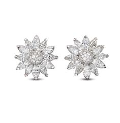 For a sterling appearance, pile on the sparkle - Asprey gold and diamond earrings