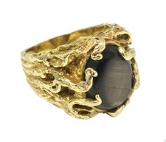 A men's 14-karat gold ring with black star sapphire given to Al Strada by Elvis Presley during a concert.