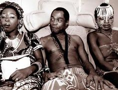 "Fela Kuti and two of his 27 wives - Brief summary: Fela Anikulapo Kuti, born in Abeokuta, Nigeria, is known for being the godfather of the popular West African musical genre of Afrobeat (mixture of soul, jazz, highlife and funk). ""Stage presence"" should be synonymous with ""Fela Kuti""."