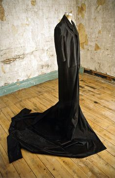 Yohji Yamamoto, black two-layered and oversized coat, Spring–Summer 2001. Collection of the Museum at FIT