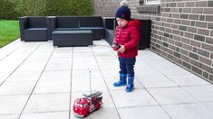 Funny baby playing with Disney Pixar Cars RC Red Fire Engine Fight fires with this Disney Pixar Cars Radio Controlled Red the Fire Engine! Equipped with a th...