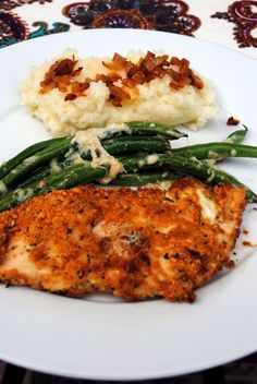 You can either bake or fry the chicken. If baking, heat oven to 475. Place chicken in a baking dish and bake about 15-20 minutes. If frying, heat a pan over medium heat and add some olive oil