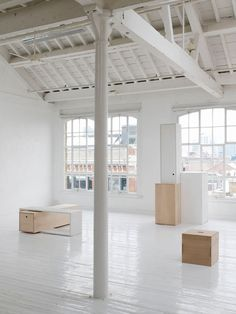 white loft space for minimal industrial | white painted gabled ceiling