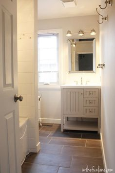 Life in the Fun Lane bathroom. Love the floor tile pattern and gray vanity. Simple and pretty.