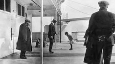 Six year old Robert Douglas Spedden playing with a spinning top on deck, watched by his father and other passengers  ~ Titanic carried 2,224 passengers and crew - young and old - from millionaires, to teachers and emigrants. First-class guests enjoyed luxury rooms and restaurants, while second-class quarters were compact. Third-class berths were out of sight near the bottom of the ship. [IrishPictureLibrary/FatherBrowneSJCollection]