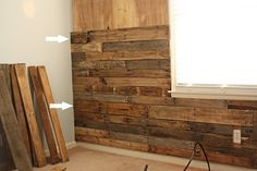Using Pallets to create a rustic wall--I sooo want to do a feature wall in my living/dining room, but make sure you sand and seal each piece or dog hair will stick to it like velcro! (on the washer and dryer wall)