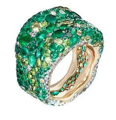Fabergé Emotion ring pavé set with emeralds and other green coloured gemstones.