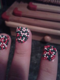 Christmas nails easy as 123. 1) base coat 2) sprinkles 3) clear coat. Last for about a week :)