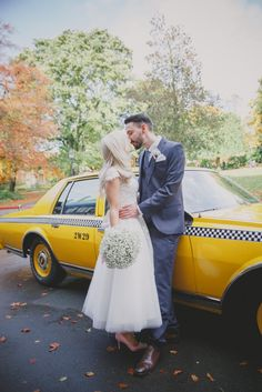 You can't beat a yellow cab! Real Bride Leanne wearing a House of Mooshki dress from Lace & Co. Bridal Boutique