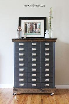 Turn an old metal filing cabinet into and industrial furniture makeover with a little paint and wood! | www.mydiyenvy.com