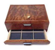 Mikutowski Woodworking - One Drawer Bubinga Jewelry Box Shown here is the Bubinga one drawer Jewelry Box from Mikutowski Woodworking. Accented with Wenge feet, handle and spline miter joints, the cont