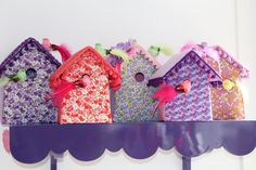 Fabric covered cardboard bird houses are handmade with love, trimmed with care.
