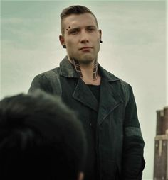 """""""Listen up!""""  I tilt my head towards the young man standing on the ledge of the building. He meets my gaze, and lifts his pierced brow. """"I'm Eric."""" He says, """"One of your leaders here in Dauntless."""" The first thing I notice are his eyes. I can't quite describe what's wrong with them, but there's this coldness peeking through, that gives me shivers."""
