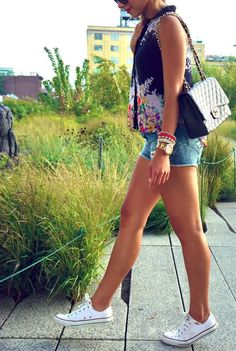 denim shorts, a bold top and white converse