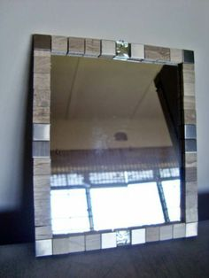 tiles as mirror frame; love the concept, hate the colors