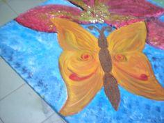 una farfalla in 3d su un fiore in pittura acrilica su tela