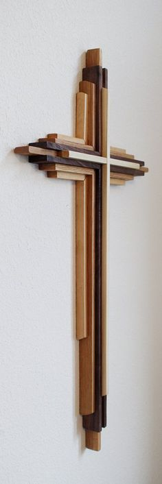 Custom made large wooden crosses 3 to 8 feet tall. Materials Made from three separate types of solid wood. I can use any combination of domestic woods you prefer. Popular wood choices are maple, oak, & walnut, but I can use any domestic woods you choose. DenneheyDesign.com