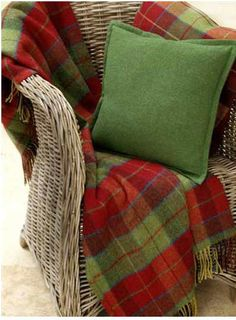 Foxford Red and Green Check Irish Made Blanket (5261)  This blanket is a true Irish classic and measures 57 x 64 Inches.   Foxford Woolen Mills, Established since 1892 in Mayo Ireland, Foxford Woolen Mills has a long history of producing quality woven woolen products from famine times right up until today.  100% Lambswool from Ireland.  $119.00