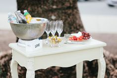 Cream vintage table with drinks station and cheese platter- wedding ceremony