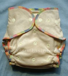 Shipping info: This item does not qualify for free shipping until you reach a minimum of $75.  Orders over $75 ship free via to the US, Canada and Australia via AIRLIFT (2-6 weeks) with coupon code 75SHIPFREE at checkout.                     One Size Bamboo Fitted Diaper     Our one size fitted diapers are made from a natural, unbleached bamboo cotton blend viscose.  We combine velvety soft bamboo velour with strong and absorbent bamboo fleece for an incredibly soft, absorbent, adjustable and quick drying diaper.   The outside of our one size bamboo diaper is made of soft bamboo velour, trimmed with a cheery, gender neutral rainbow thread :       This diaper is completely adjustable to fit a wide range of sizes.  Three step front rise snaps adjust as shown to fit small, medium and large.  The front wings have crossover snaps give a perfect fit on smaller settings.  Please note that this diaper does run small.  It may fit earlier than other one size fitted diapers, but may not take a chunky toddler all the way through potty training.      The inside layer of the diaper body is strong and absorbent bamboo fleece.  There are also two inserts that allow you to customize absorbency.  One is sewn in to the front of the diaper and can be folded down according to the size of your baby and rise snap setting.  The sewn in insert is one layer of bamboo fleece topped with one layer of bamboo velour:      An additional snap in insert is included; this is made from two thirsty layers of bamboo fleece. This makes a total of 4 layers of bamboo fleece and two layers of bamboo velour, but nothing is more than two layers thick.  You'll find these dry quickly compared to other cloth diapers, whether you use a dryer or hang on a line.  If you need extra absorbency for naptime or nightime, see our other inserts which can be tucked under the sewn in liner.  We think that for really heavy wetters, a combination of bamboo and microfleece cannot be beat!     Diaper body fabric content: Bamboo velour outer: 55% bamboo, 22% cotton, 23% polyester.  Diaper inner bamboo fleece: 70% bamboo, 30% cotton.    Diaper doubler fabric content: Bamboo fleece insert layers: 70% bamboo, 30% cotton Bamboo velour insert layer:  55% bamboo, 22% cotton, 23% polyester.