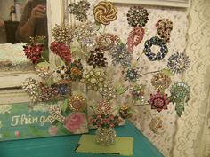 These would make great decor for Christmas ornaments  Brooch Tree Display by MyInnerPrincess, via Flickr