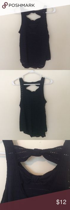 Perforated bow back tank Gently worn, no flaws. Selling because my bra always sticks out - I'm large chested so can't go without! Polyester and viscose. True to size with some stretch. It may look black in the photos but it is indeed navy! Offers and bundles welcome! Abercrombie & Fitch Tops Tank Tops