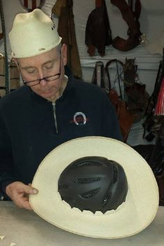 Step 6, spray the brim with water to soften up the pies, then press it down evenly over the crown of the helmet. Position so it sits the way you want it when the helmet is on your head