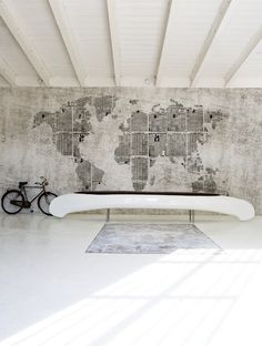 Interesting. A canoe gets a second life as a bench. And a new wallpaper with a map of the world (when?) from Wall and Deco.