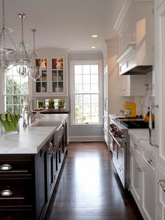Kitchens by Deane - two tone cabinets. Dark island with white cabinets and countertops
