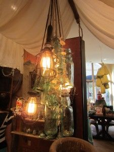 Fun use of old glass. Could use mason jars, old insulators from power poles, old glass shades. String electric cord through and have a central junction. Jack could do that...He can do just about anything.