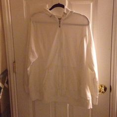 A white, zip up sports jacket Very soft white jacket! Great for working out! Worn 2 times. Style & Co Tops
