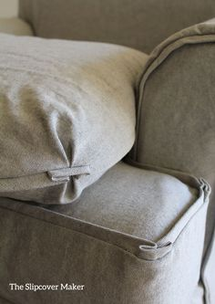 French flange trim on slipcover cushions in yarn dyed grey canvas.
