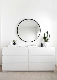 IKEA MALM dresser in white. I'd use this set up for the dressers, on the wall thats at the end of the bed. Not sure whether I want the three or four drawer units though.