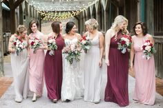 Who said winter weddings can only have dark tones! This bride mismatched her bridesmaids in burgundy, pink, and ivory