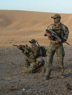 Australian SASR soldiers on patrol through the desert.