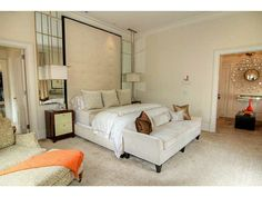 If you have room, a small sofa at the end of the bed extends lounging surfaces.