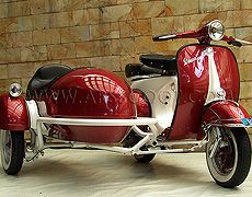Arsscoot.com - Piaggio Vespa Scooter and Sidecar   http://www.shutterstock.com/?rid=1525961
