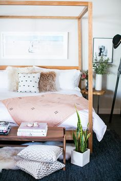 Pretty bedroom. Wood tones, white and blush pink.