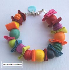 must-have #Fun Summer accessory - #Handmade Wood Beaded and Fabric Bracelet by AmandaHLCreations on #Etsy