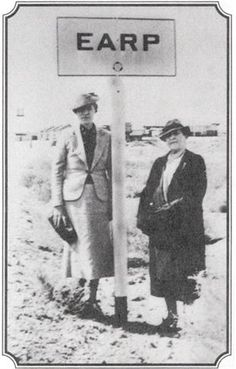 """Josephine Sarah """"Sadie"""" Earp on the right in 1937. She's standing with Vinolia Earp Ackerman, sister of Mabel Earp Cason, who was Sadie's co-biographer with her sister. They stopped at Earp, CA, enroute to Tombstone to do research for Jose's memoir. From the Boyer Collection."""