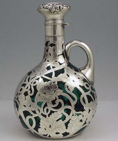 An art nouveau silver overlay decanter by the Gorham Company in 1900 (via Moz Carlson (mozcarlson) on Pinterest)