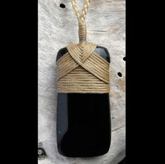 Hand carved black jade Maori style Toki necklace with traditional bindings, cord and woven presentation case.