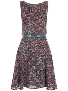 Rebecca Retro 60s Fit and Flare Dress by Darling. An all over floral print for a 1960s Psychedelic look. Finished with cute patent belt accessory. http://www.atomretro.com/product_info.cfm?product_id=12911