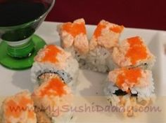 Sunset Sushi Roll: nori, sushi rice, cucumber, seafood dynamite (seafod salad), topped with spicy shrimp Sushi Take Out, Sushi Love, How To Make Sushi, Food To Make, Sushi Roll Recipes, Rice Recipes, Yummy Recipes, Sushi At Home, Sushi Party