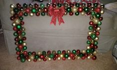 Christmas Ornament Frame- made with foam board, gold paint, and hot glue. Total cost $10! I'm using it as a photo booth at a Christmas party.
