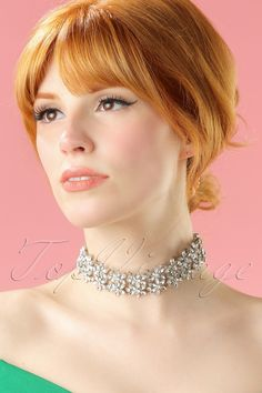 Make a grande entrance with this 40s Floral Crystal Choker around your neck! A black tie party or a fancy dinner coming up? No stress... with this eyecatching choker you probably won't be needing any more accessories to complete your outfit! The broad choker features shiny rhinestones and facetted faux diamonds in the shape of flowers en will complement your neckline. Be the ultimate glam vamp!    Choker necklace Rhinestones Silver toned metal Lobster closure Nickel free...