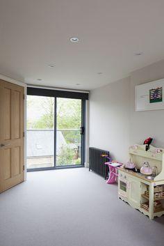 Rear dormer   Juliet balcony   Modern glass balustrade and sliding bedroom doors   Garden views   Brighton Architects
