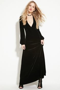 A long-sleeved maxi dress from Motel Rocks™ crafted from a knit velvet with a plunging V-neckline.