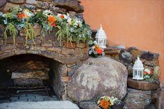 orange & teal wedding | ceremony backdrop | fireplace | lanterns, roses, dahlias, amaranths | Florist: The Moss & Rose
